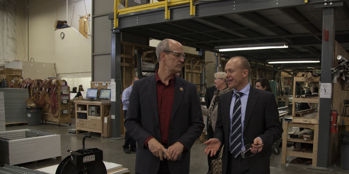 Congressman Larsen with Jim Mischel at the beginning of the tour of Electric Mirror's production facilities.