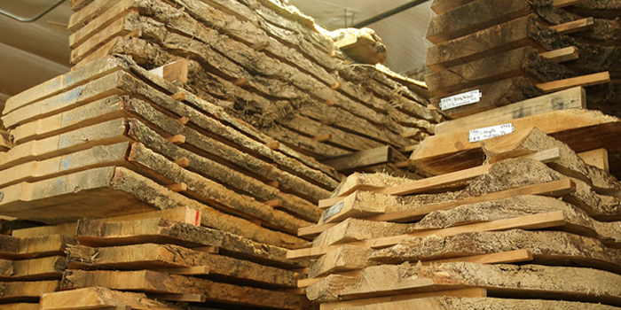 Milled slabs of recovered wood air drying at the warehouse of Urban Hardwoods.
