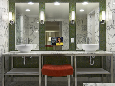 Three Loft Bathroom Mirrors with one equipped with a TV at a Flamingo Hotel super suite in Las Vegas, Nevada.