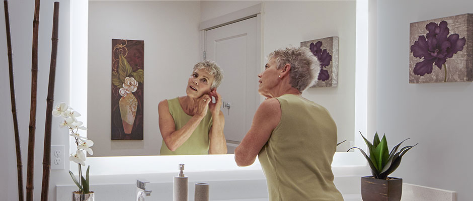 Lady-using-a-Silhouette-Lighted-Mirror