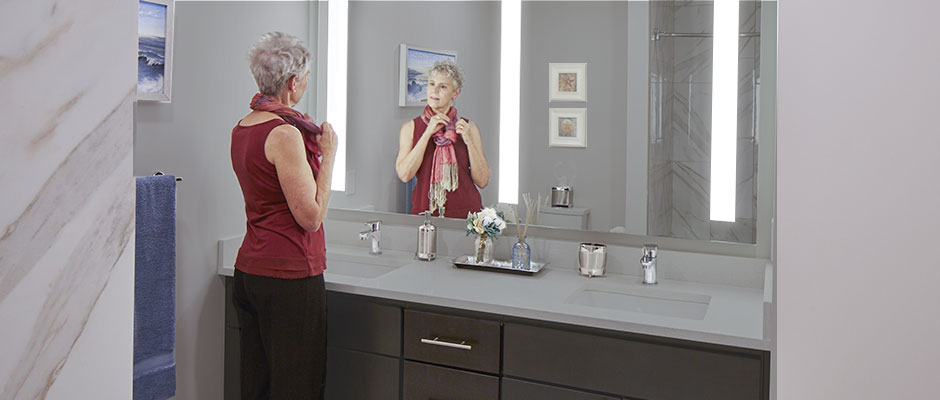Lady with a Triple Fusion Lighted Mirror
