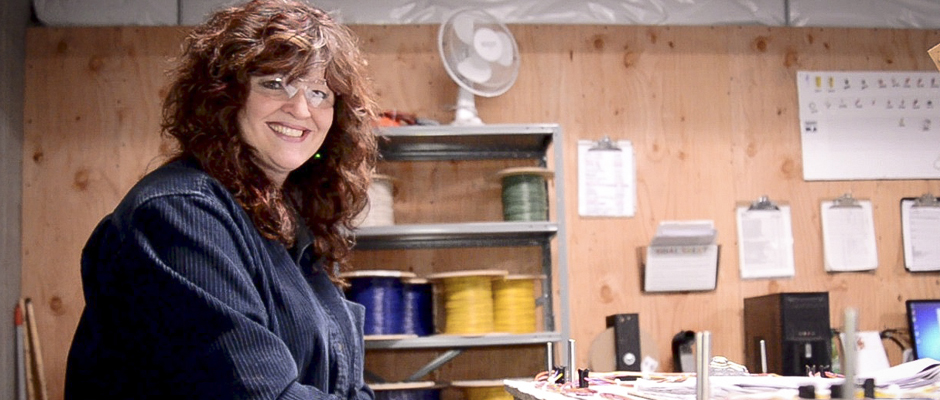 Stacy Barbeau working in wiring harnesses