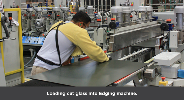 Loading cut glass into edging machine